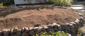Top soil on yard, a lot higher than the wall.