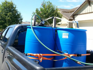 Two 55 gallon barrels in a Tacoma.