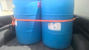 4 - 55 gallon barrels in a pickup truck