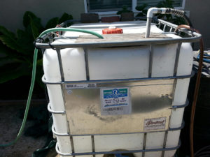 Recycled water temporarily stored in a tote prior to use.