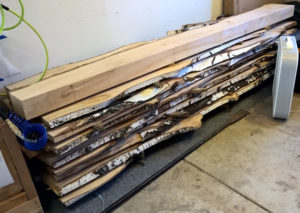 Wood stacked in garage to dry.